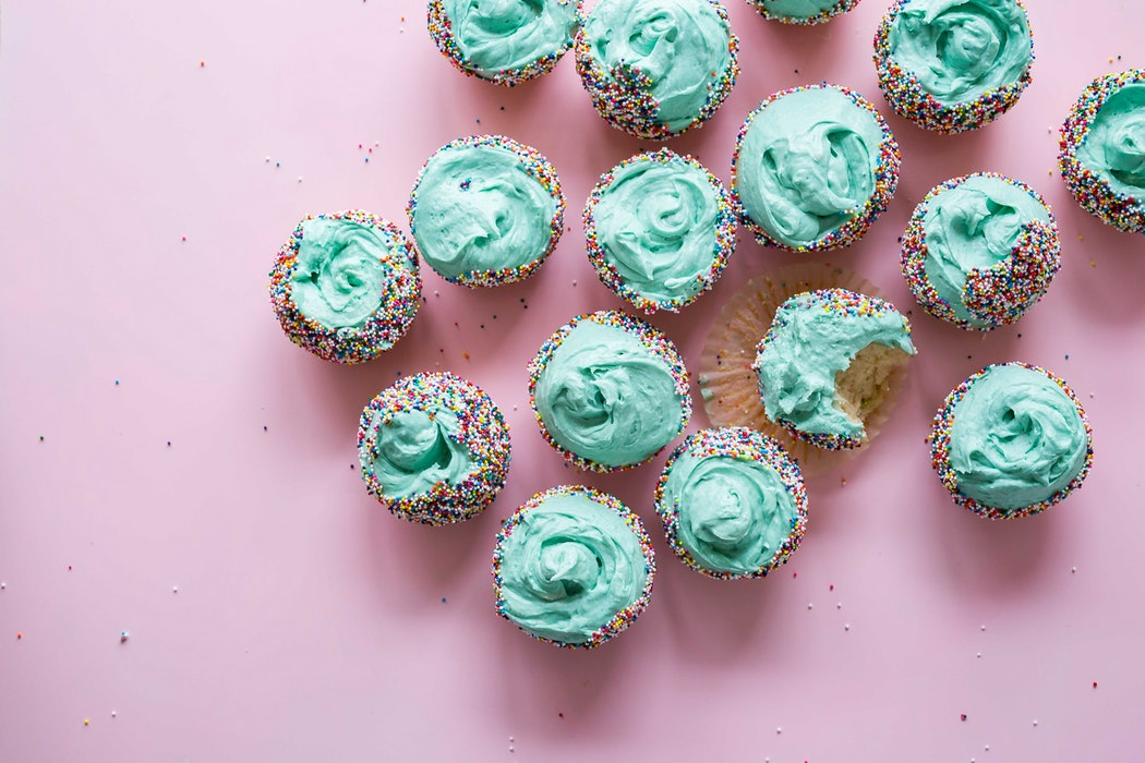 Blue cupcakes with a pink background